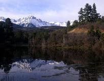 Mt. Sneffels Reflection. Mt. Sneffels reflecting in a lake stock images