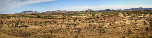 Panoramic of the desert in the west McDonnell range with Mt Sonder at the back, Northern Territory, Australia. Mt Sonder is 130 km 81 mi west of Alice Springs royalty free stock images