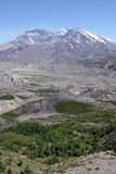 Mt St Helens. Mt. St. Helen's from a distance with surrounding mountains, and vegetation Royalty Free Stock Image