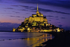 Mt.St.Michel. Abbey in Normandy, France, shot after sunset as tide was coming in. Photographed from causeway Royalty Free Stock Photography