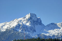 Mt. Tantalus at the southern end of the Coastal Mountains of British Columbia, Canada against blue sky Stock Image
