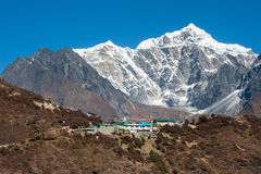 Mt Tawoche and Mongla village, Everest region, Nepal. Mongla village, with Tawoche peak in background, Everest region, Nepal Royalty Free Stock Image