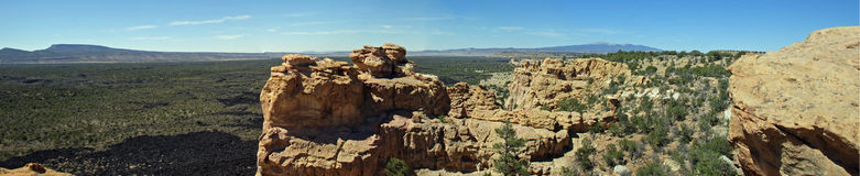 Mt. Taylor and the Malpais panorama. True wide panorama of Mount Taylor, a sacred mountain to the local Native American tribes, and the sandstone formations and Royalty Free Stock Photo