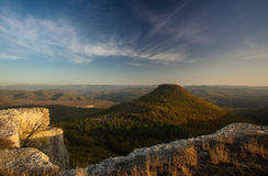 Mt. Tepe-Kermen. Conical mesa at sunset in Crimea Royalty Free Stock Image