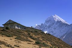 Mt. Thamserku and lodge Stock Photo