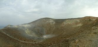 Mt Vulcano 3. Panoramic view of the main crater of Mt. Vulcano, located on the Eolian Isles north of Sicily, Italy. The yellowish fuming rocks is where the Royalty Free Stock Photos