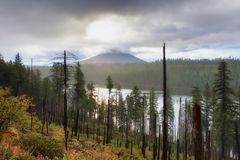 Mt Washington Cascade Volcano in Oregon. Early morning sunrise view of Mt. Washington along the scenic byway of Oregon`s McKenzie Pass - Santiam Pass. Early Fall stock photography