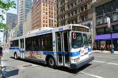 MTA Bus Route 5 on Fifth Ave, NYC, USA. MTA Hybrid Electric Bus Route 5 on Fifth Avenue at 42nd Street, New York City, USA Royalty Free Stock Image