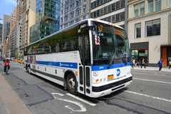 MTA Bus Route x7 on Fifth Ave, NYC, USA. MTA Hybrid Electric Bus Route x7 on Fifth Avenue at 42nd Street, New York City, USA Royalty Free Stock Photography