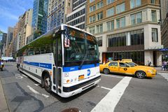 MTA Bus Route x7 on Fifth Ave, NYC, USA. MTA Hybrid Electric Bus Route x7 on Fifth Avenue at 42nd Street, New York City, USA Stock Photo