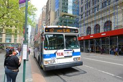 MTA Bus Route m2 on Fifth Ave, NYC, USA. MTA Hybrid Electric Bus Route m2 on Fifth Avenue at 42nd Street, New York City, USA Royalty Free Stock Images