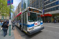 MTA Bus Route m2 on Fifth Ave, NYC, USA. MTA Hybrid Electric Bus Route m2 on Fifth Avenue at 42nd Street, New York City, USA Stock Photography
