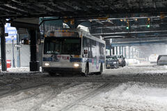 MTA bus travels during snowstorm in the Bronx. BRONX, NEW YORK - MARCH 14:  MTA bus rides during snow storm.  Taken March 14, 2017 in New York Royalty Free Stock Photography