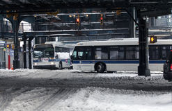 MTA buses travel during snowstorm in the Bronx. BRONX, NEW YORK - MARCH 14:  MTA buses ride during snow storm.  Taken March 14, 2017 in New York Royalty Free Stock Images