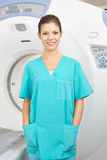 MTA in front of MRI machine in radiology. Young MTA in front of MRI machine in radiology in a hospital Stock Photos