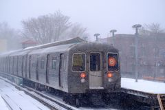 MTA subway train at the station on snowy day royalty free stock photography