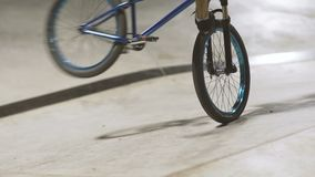 MTB bicycle rider does various tricks while riding in skatepark . Extreme Sports, rider does tailwhip at nigh stock footage
