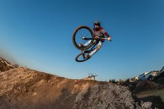 MTB Bike jump over a dirt trail stock photography