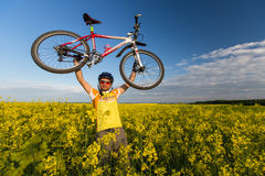 Mtb biker is holding bicycle Stock Image