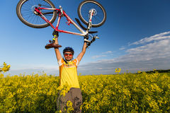 Mtb biker is holding bicycle Stock Images