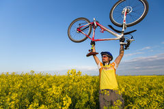 Mtb biker is holding bicycle Royalty Free Stock Photos