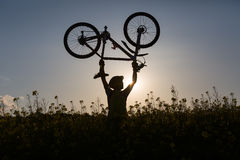 Mtb biker is holding bicycle Royalty Free Stock Images
