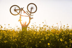 Mtb biker is holding bicycle Royalty Free Stock Image