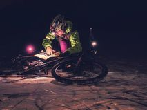 Extreme orienteering bike race. Cyclist check map royalty free stock photography