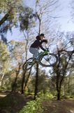 Mtb dirt jam, x up. Rider flying over a jump x up Royalty Free Stock Image