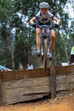 MTB Girl flight Drop. Practice lap for female woman Athlete Cyclists in mid flight at drop steps. The Challenge at the amphitheater obstacles for cycling Royalty Free Stock Photos