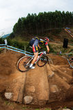 MTB Male Vertical Steep Steps. Practice lap for Male Athlete Cyclists grinding down the vertical log steps. The Challenge at the amphitheater obstacles for Royalty Free Stock Photography