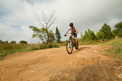 MTB rider on gravel road Royalty Free Stock Image