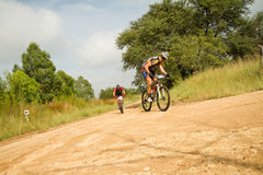 MTB Rider looking back at competitor Royalty Free Stock Photography