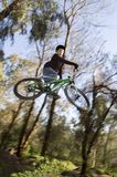 Mtb whip. Rider jumping over a jump in great style Royalty Free Stock Photography