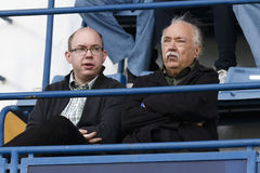 MTK vs. Gyor OTP Bank League football match. BUDAPEST - SEPTEMBER 15: Hungarian humorist and journalist, Tivadar Farkashazy (R) and his son during MTK vs. Gyor Stock Images