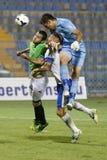 MTK vs. Haladas OTP Bank League football match. BUDAPEST - AUGUST 9: Goalkeeper Federico Groppioni of MTK (R) heads the ball after corner kick behind his stock photo