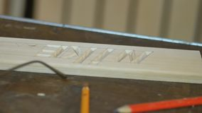 Mtsensk, Russia. 20 Dec 2016. Editorial - Nike artistic wood carving , closeup, tool, old man, Santa Claus carving close