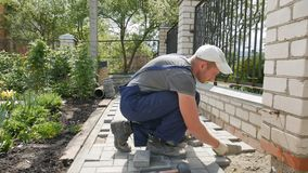 Mtsensk, Russia 24 May 2017. EDITORIAL - Bricklayer lays paving stone mosaic.