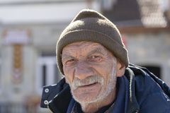 Portrait of old man with a gray beard near old orthodox cathedral in town Mtskheta near Tbilisi, Georgia royalty free stock photos