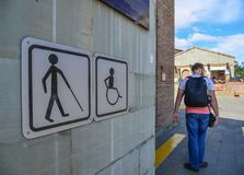 Public restroom signs with a disabled access symbol stock photography