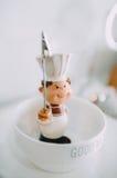 Muñeca de la decoración de la tabla fotografía de archivo libre de regalías