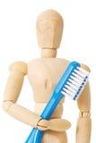 Muñeca de madera con el cepillo de dientes Foto de archivo libre de regalías