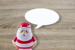 Muñeca de Santa Claus en fondo de madera Fotos de archivo