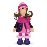 Muñeca de Tilda Muchacha en ropa del invierno: sombrero rosado con el pom-pom, una bufanda caliente, botas, y una capa azul Perso Fotos de archivo