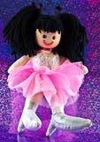Muñeca de trapo en fondo floral Imagen de archivo