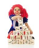 Muñeca de trapo que juega bloques Foto de archivo libre de regalías