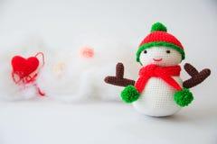 Muñeca del muñeco de nieve que hace punto Imagen de archivo libre de regalías