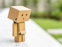 Muñeca deprimida de la caja Fotografía de archivo libre de regalías