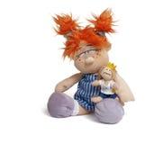 Muñeca divertida principal roja foto de archivo