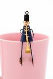 Muñeca en la taza Imagenes de archivo